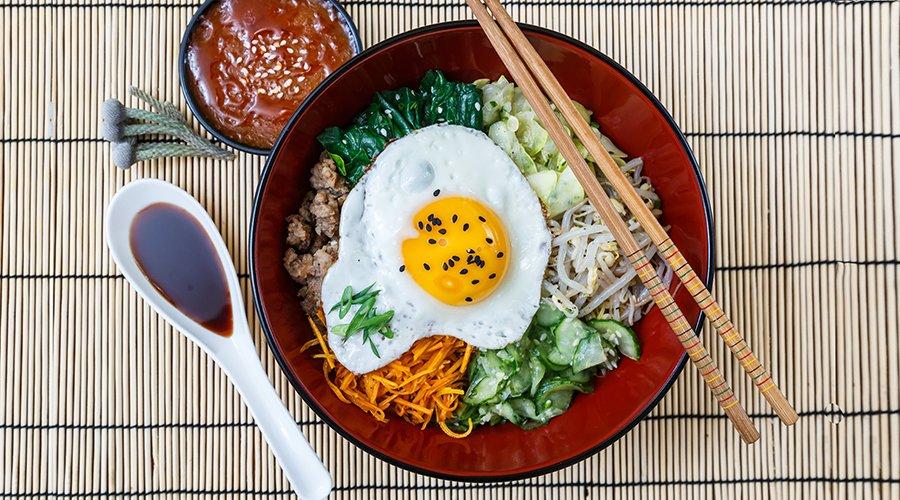 bibimbap in a bowl, korean dish from top.